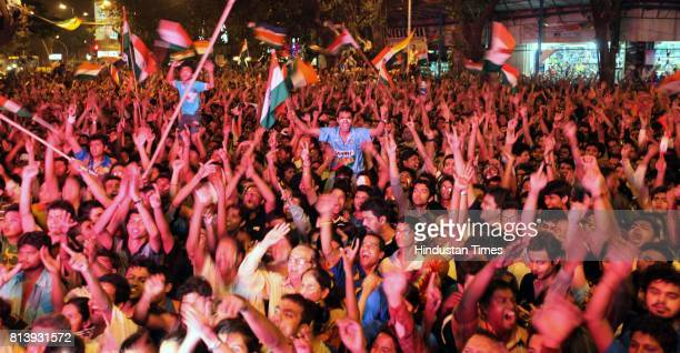 Residents of Dadar celebrates after wining the world cup in Shvaji Park as they enjoy World Cup final match between India and Sri Lanka on the giant...