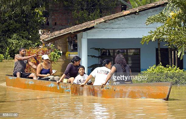 Residents of Domingolargo in the Colombian department of Valle del Cauca, use a canoe to move through flood waters after the overflowing of the Cauca...