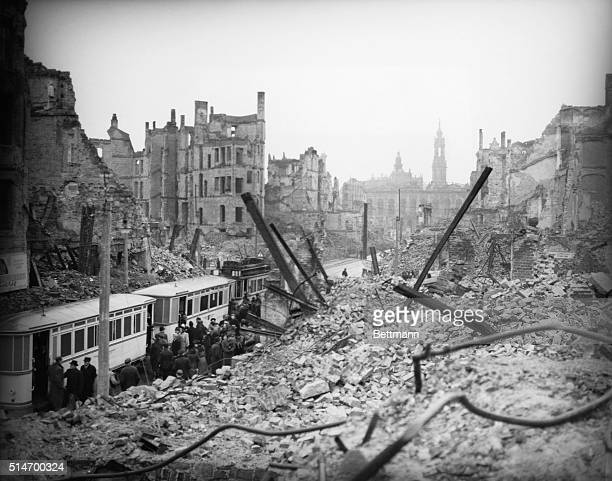 Residents of Dresden line up for a streetcar amid the ruins of the city It was heavily bombed by the Allied forces in early 1945