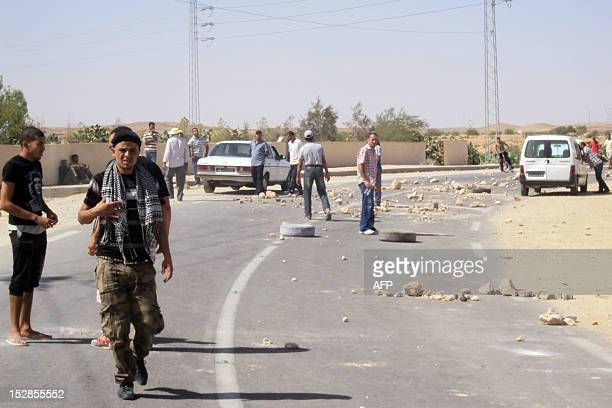 Residents of El Omrane in the Sidi Bouzid region where four football referees were taken hostage on September 26 block the road on September 27 2012...