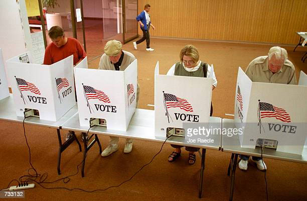 Residents of El Paso, Texas cast their ballot for president of the United States in early voting, October 23, 2000. The state of Texas has early...