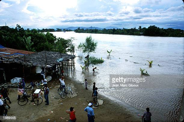 Residents of El Progresso Honduras watch the rising waters of the Ulva River October 1999 In October 1998 Hurricane Mitch roared through Central...