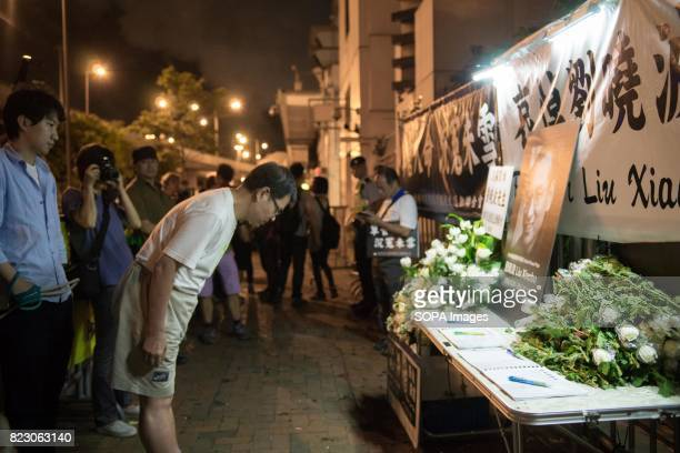 Residents of Hong Kong hosted a vigil service outside the Chinese Liaison Office of Hong Kong after the death of Human Right Activist and Nobel Peace...