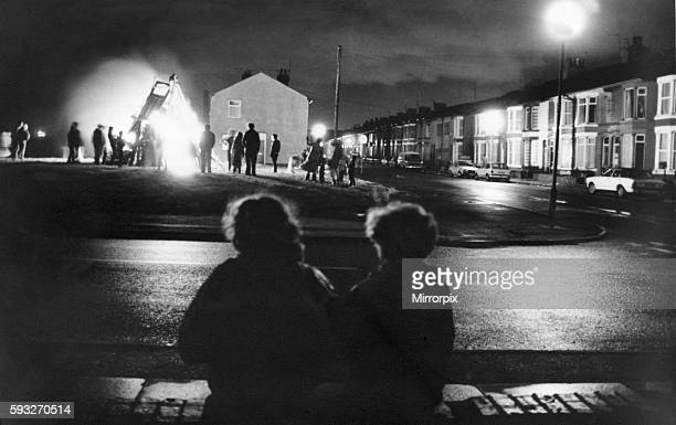 Residents of Hornby Boulevard Bootle gather to watch a private bonfire and fireworks display 5th November 1993