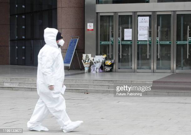 WUHAN CHINA FEBRUARY 7 2020 Residents of Houhu Hospital District Wuhan Central Hospital flowers for the dead Doctor Li Wenliang Wuhan Hubei Province...