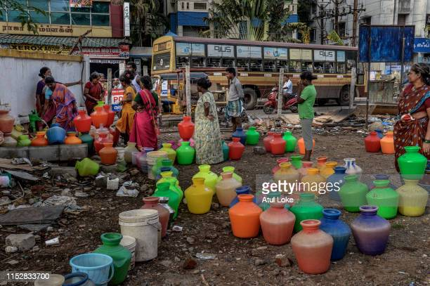 Residents of housing board complex in Chennai city stand in line and fill water from common tab on June 29 2019 The locals mentioned they get water...