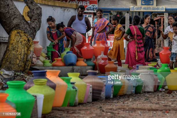 Residents of housing board complex in Chennai city stand in line and fill water from common tab on June 29, 2019. The locals mentioned they get water...