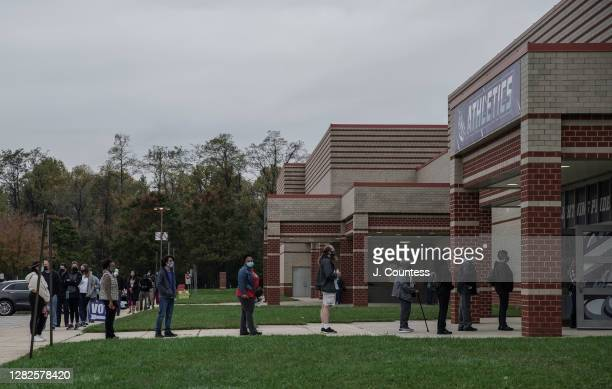 Residents of Howard County line up at Long Reach High School to vote as early voting continues for a second day in the state of Maryland on October...