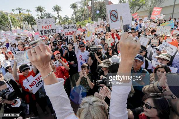 Residents of Irvine, Huntington Beach and Laguna Niguel protest outside as OC Board of Supervisors discuss tent city for homeless in their community....