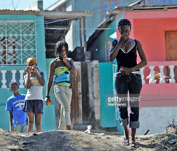 Residents of Jacmel Haiti make their way past a vocational school where a number of students perished on Friday January 15 2010 Relief groups and...