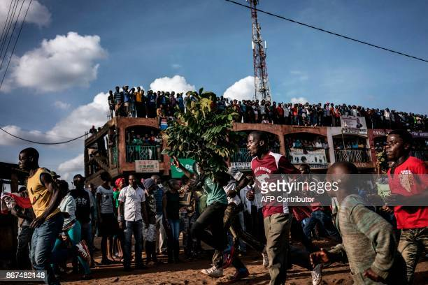 Residents of Kawangware gather in the streets in Nairobi on October 28 after hearing a rumour that Kenyan opposition leader Raila Odinga would come...