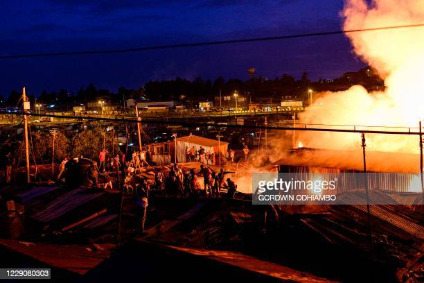 Residents of Kibera fight a fire from the rooftops that gutted shantees in the Maranatha area of the sprawling slum that started at dusk in Nairobi...