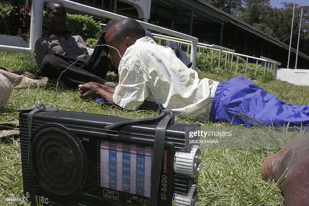 Residents of Kibera listening to the rad : News Photo