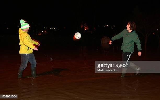 Residents of Kingsmeadows Road keep their spirits up by having a light hearted game of football in the flooded street after managing to keep flood...
