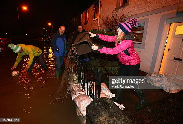 Residents of Kingsmeadows Road only just managing to keep flood water from entering their homes after rain fall from Storm Frank caused the river...