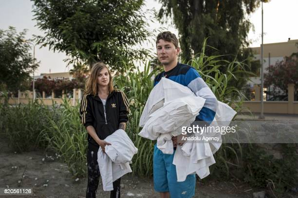 Residents of Kos Island those affected by the Fridaymorning earthquake in the Aegean Sea are seen after spending their time outside as a precaution...
