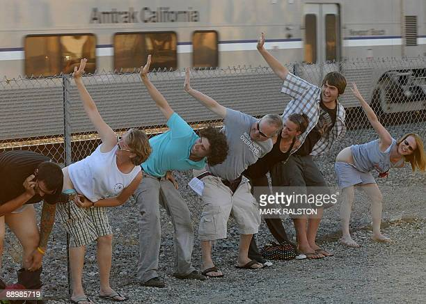 Residents of Laguna Niguel expose their buttocks during the 30th annual Mooning of the trains event along a stretch of railroad track in Orange...