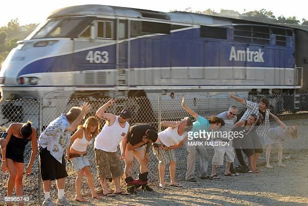 """Residents of Laguna Niguel expose their buttocks during the 30th annual """"Mooning of the trains"""" event along a stretch of railroad track in Orange..."""