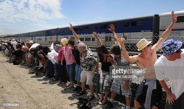 Residents of Laguna Niguel expose their buttocks to a passing Amtrak train during the 31st annual Mooning of the trains event along a stretch of...