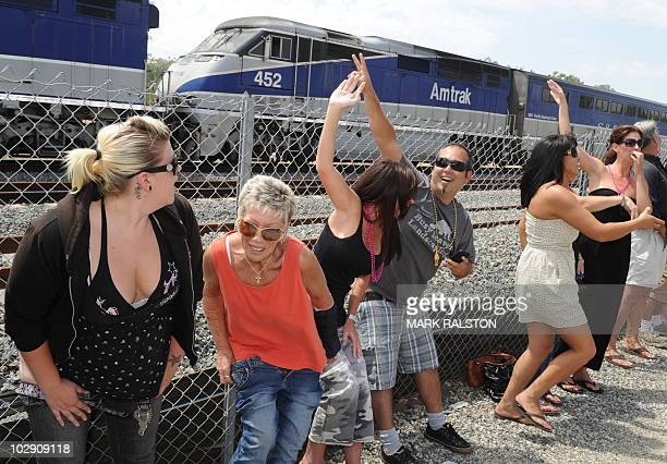 """Residents of Laguna Niguel expose their buttocks to a passing Amtrak train during the 31st annual """"Mooning of the trains"""" event along a stretch of..."""