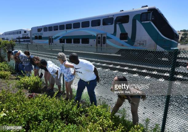 """Residents of Laguna Niguel expose their buttocks to a passing Metrolink train during the annual """"Mooning of the trains"""" event along a stretch of..."""