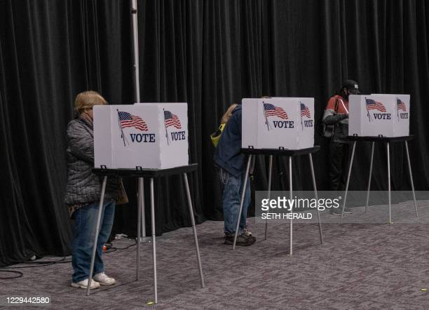 Residents of Lansing, Michigan, cast their votes November 3 at the Lansing Public Media Center a polling station.