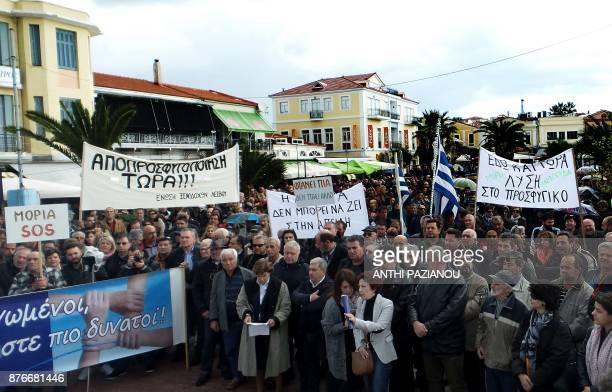 Residents of Lesbos island hold banners as they demonstrate in the town of Mytilene on the island of Lesbos in November 20 2017 during a general...