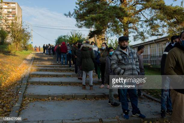 Residents of Lunik IX borough line up on the street early in the morning to participate in antigen testing for Covid-19 at a nearby school on...