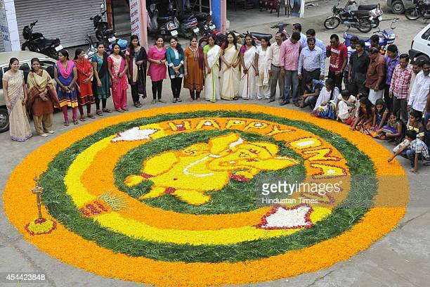 Residents of Mahabali Nagar and nearby Malayali community decorated a big Pookalam a rangoli made by using flowers to welcome emperor Mahabali on the...