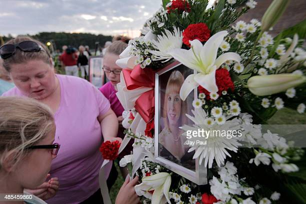 Residents of Martinsville attend candlelight vigil for Alison Parker on Martinsville High School's football field on August 27, 2015 in Martinsville,...