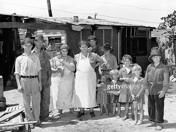 Residents of May's Avenue Camp near Oklahoma City Oklahoma standing in front of a shack July 1939