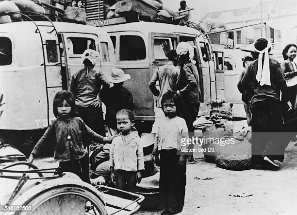Residents of Nam Dinh leave the third largest city in the Tonkin Delta with their belongings on the run from the approaching Viet Minh - July 1954