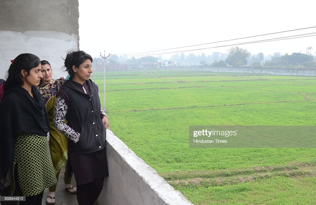 Residents of nearby village look at the Pathankot Air Force Base during a terror strike on January 4 2015 in Pathankot India Seven soldiers and at...