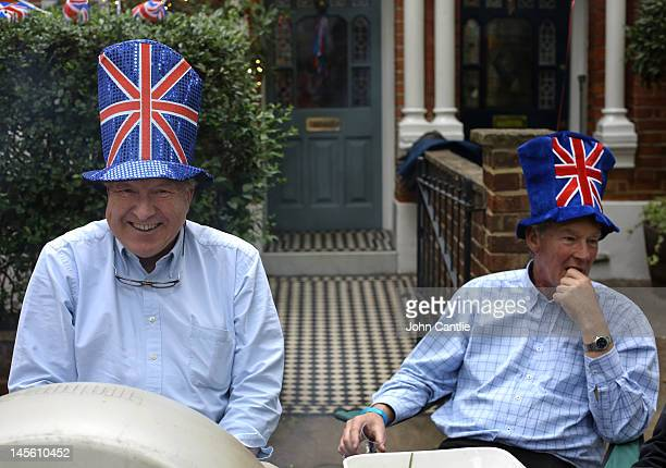 Residents of Niton Street wear Union Jack hats and light the barbeque during a street party on June 2 2012 in Fulham southwest London England For...