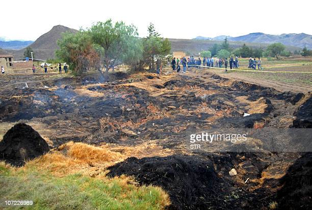 Residents of Nueva Felicidad community in Villa Rivero municipality Cochabamba department Bolivia observe a subsidence and fire coming from the...