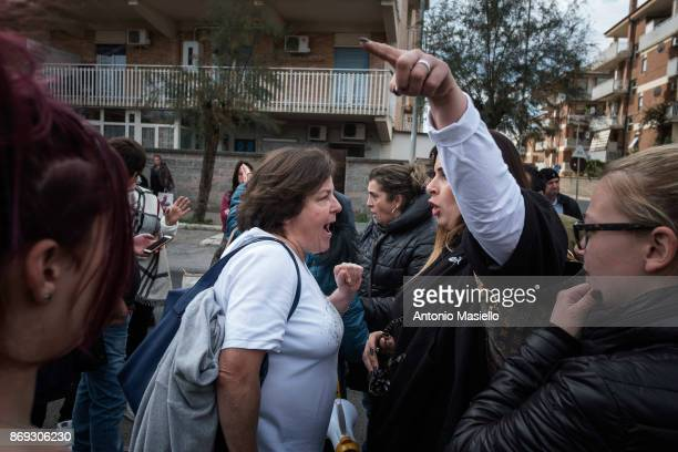 Residents of Ostia's city hall react on the street during the protest against the evictions and deterioration of the suburb of Rome on October 31...