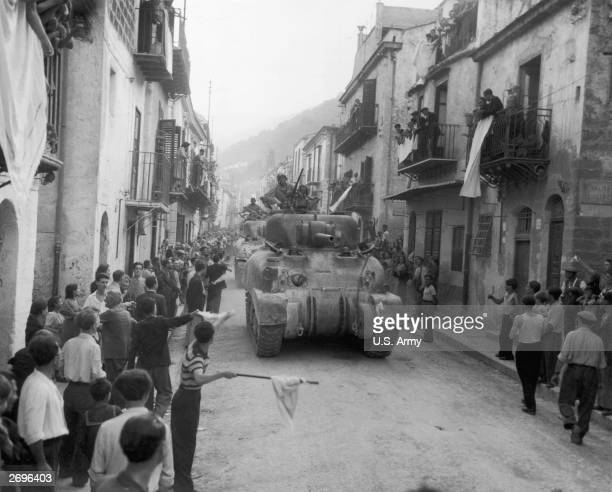 Residents of Palermo Sicily line the streets to greet the American Sherman tanks after the town had surrendered to the Allies