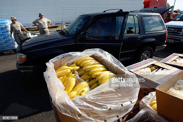 Residents of Pasadena, TX drive up to receive ice, water, and food from members of the Texas National Guard after being affected by Hurricane Ike...