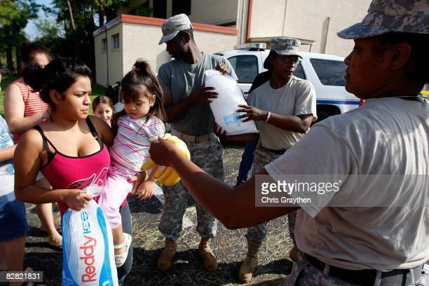 Residents of Pasadena TX receive ice water and food from members of the Texas National Guard after being affected by Hurricane Ike September 15 2008...