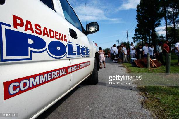 Residents of Pasadena, TX wait in line to receive ice, water, and food from members of the Texas National Guard after being affected by Hurricane Ike...