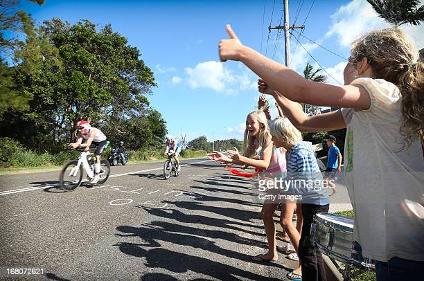 Residents of Port Macquarie support athletes as they ride along Matthew Flinders Drive in Port Macquarie during the Port Macquarie round of the 2013...