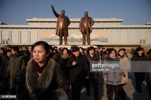 TOPSHOT Residents of Pyongyang pay their respects before the statues of Kim Il Sung and Kim Jong Il during festivities to mark the 76th anniversary...