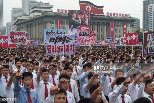 Residents of Pyongyang take part in a mass rally marking the start of the Korean War in Kim IlSung square in Pyongyang on June 25 2017 North Korea...