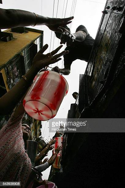 Residents of Raghuveer Nagar Dombivli rushing to fill their buckets with water which is supplied to them from tanker by the local corporator on July...