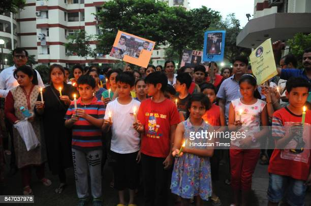 Residents of Rail Vihar society hold candle march at sector15 part2 to mourn the death of Ryan International School student Pradhuman Thakur on...