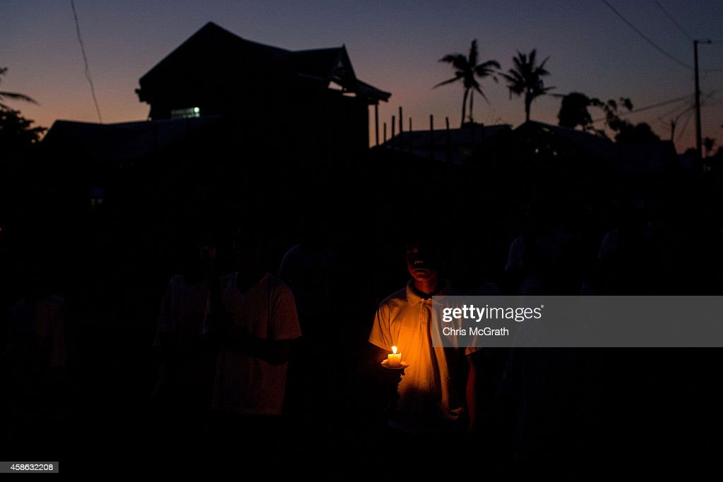 TACLOBAN, LEYTE, PHILIPPINES - NOVEMBER 08: Residents of San Joaquin walk through the towns streets during a dawn candle light procession on November 8, 2014 in Tacloban, Leyte, Philippines. Residents and typhoon survivors from across the central Philippines attended memorial services and visited mass graves honouring those who lost their lives one year ago when Typhoon Haiyan, the strongest typhoon ever to make landfall swept across the region, leaving more than 6000 dead and many more homeless.