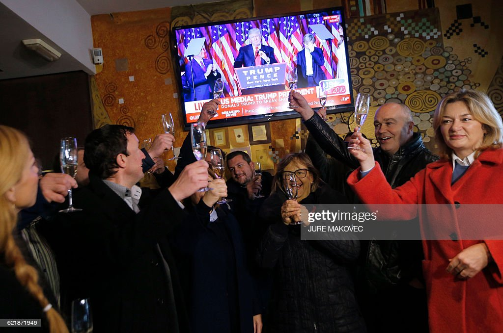 Residents of Sevnica, hometown of Melania Trump, wife of Republican presidential elect Donald Trump, raise glasses as they celebrate the victory of Donald Trump in the race for the White House in Sevnica, Slovenia on November 9, 2016. Republican Donald Trump has won the US presidency with at least 290 electoral votes, securing more than the 270 he needed to succeed Barack Obama. / AFP / Jure MAKOVEC