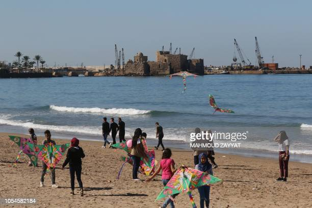 Residents of Sidon fly kites on the beach during an event organised by Pink Steps Lebanon to raise awareness about breast cancer on October 28 2018
