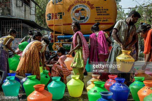 Residents of slum fill water cans with government provided tanker. The locals mentioned they get water every alternate day. All the four major...