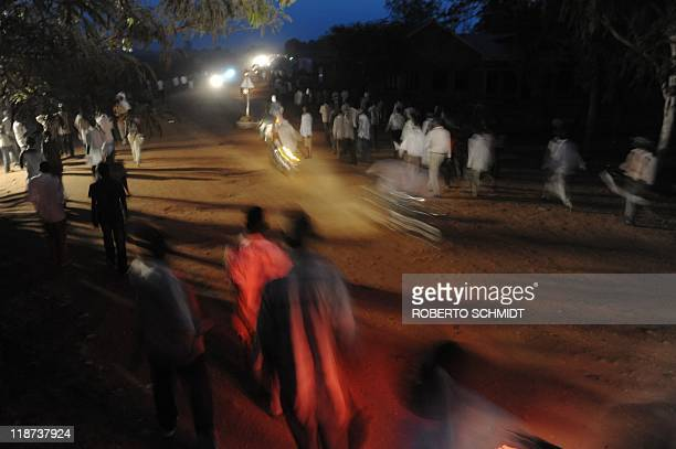 Residents of South Sudan's capital Juba make their way home after watching at a local stadium the first international soccer game for the national...